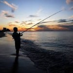 ADCNR kid fishing in shadow