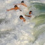 gulf shores waves kids in surf
