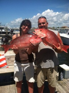 orange beach fishing charter walk on couple with red snapper catch