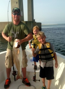 Father and sons inshore fishing for redfish at Perdido Pass AL