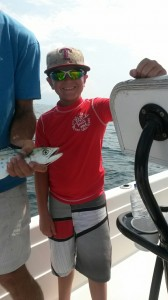 young angler with a big smile mackerel fishing along the AL gulf coast