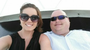 Big smiles from a LA couple enjoying a romantic sunset cruise on a 6 pack charter boat