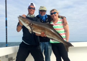 Big Cobia caught fishing off the AL Gulf Coast Captain Ben Fairey & his wife Jaime
