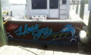hoss fly fishing six passenger charter boat docked at Flora-Bama marina on the AL/FL state line