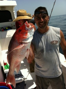 gulf shores al fishing charter red snapper deep sea fishing angler and a BIG red snapper