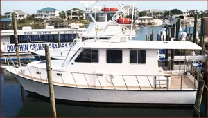 6 pack charter boat Jus Cuz docked at Flora-bama Marina on the AL/FL state line