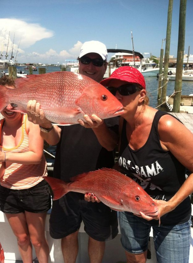deep sea fishing for red snapper on the AL/FL state line & loving it. Mack family kissing their big red snappers