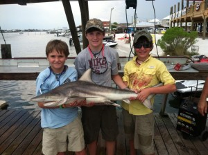 gulf shores al shark fishing charters three proud boy on the dock with a shark
