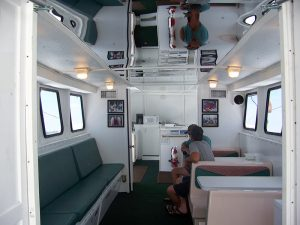 spacious air conditioned cabin of the AL Party Boat Emerald Spirit