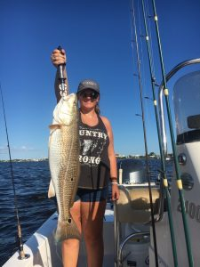 Big Redfish (red drum) reeled in by a lady angler along the Alabama Gulf Coast Fall 2016